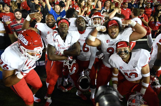 Fresno State players celebrate their 38-14 win over UCLA.