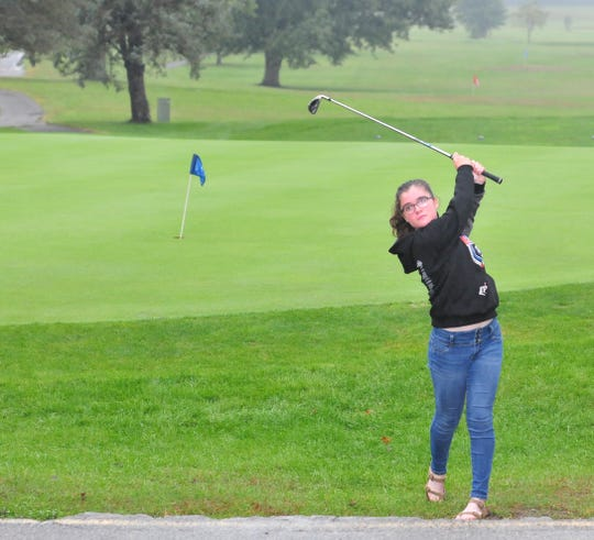 Richmond High School girls golf freshman Esther Etherington at Richmond Elks Country Club Monday, Sept. 24, 2018.