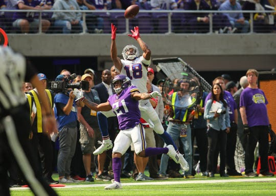 Buffalo's Andre Holmes goes up for the ball over defender Mike Hughes  of the Vikings. The play was ruled incomplete.