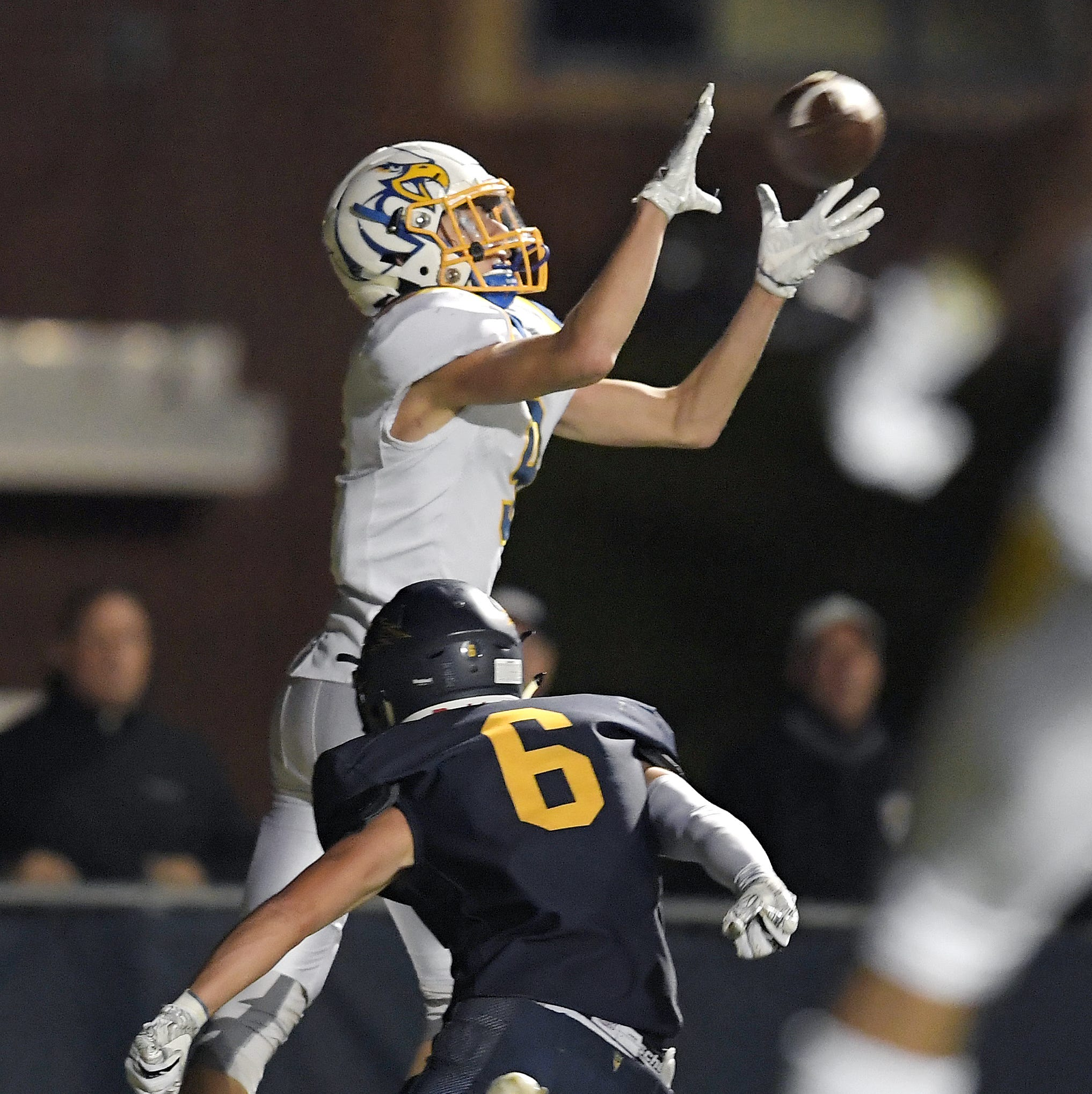 Irondequoit's Quinn Simonson, top, catches a touchdown pass over Victor's Timmy Keohane for a 21-14 lead Sept. 23, 2018.