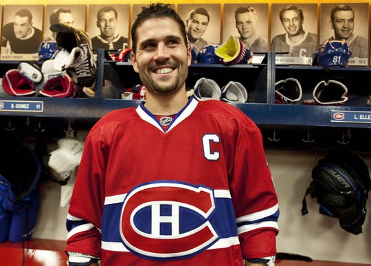 Montreal Canadiens' Brian Gionta smiles in the dressing room after being named captain of the NHL hockey team Wednesday, Sept.  29, 2010 in Montreal.