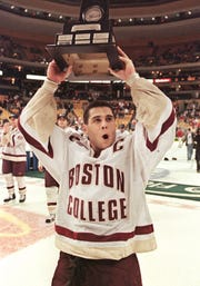 Boston College captain Brian Gionta leads his team around the ice with the Hockey East trophy after Boston College defeated Providence College 5-3 in the Hockey East final in Boston, Saturday, March 17, 2001.