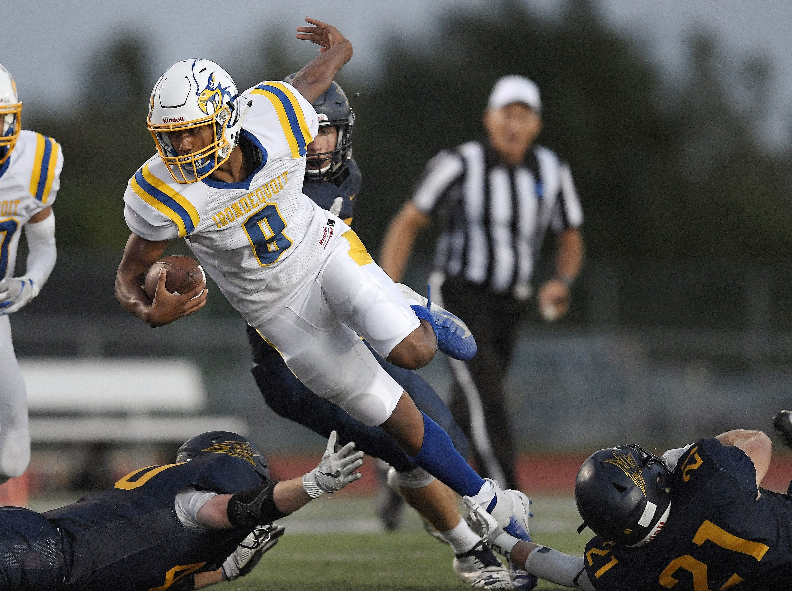 Irondequoit's Freddy June, Jr. is tripped up by Victor's Camden Hay during a regular season game played at Victor High School, Sunday, Sept. 23, 2018. Irondequoit beat Victor 28-21.