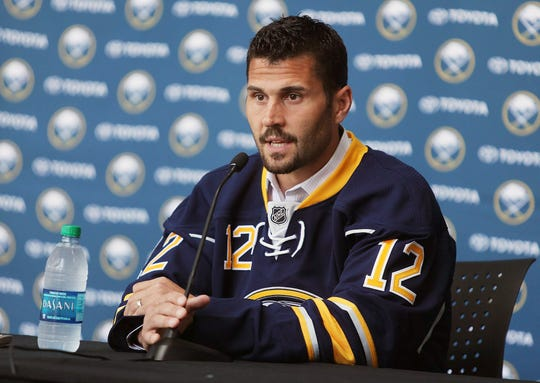 New Buffalo Sabre Brian Gionta speaks with the media after signing with  the Sabres in 2014.
