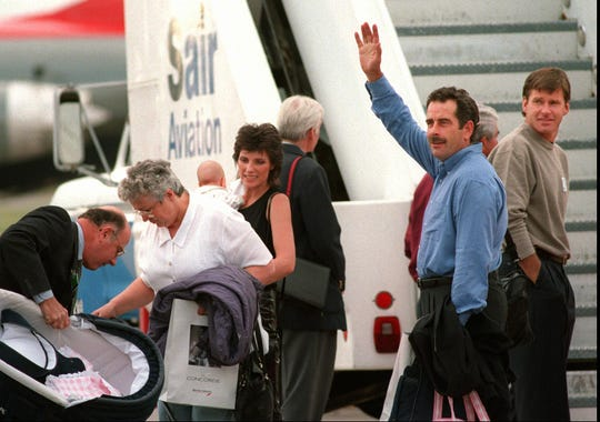 European Team member Sam Torrance, right,waves to spectators as family members gather their belongings as they got off the Concorde. Fellow team member Nick Faldo, at far right, already was in Rochester but his wife was aboard.