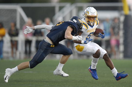 Irondequoit's Jadon Turner, right, is tackled by Victor's Sam DiGiacomo during a regular season game played at Victor High School, Sunday, Sept. 23, 2018. Irondequoit beat Victor 28-21.