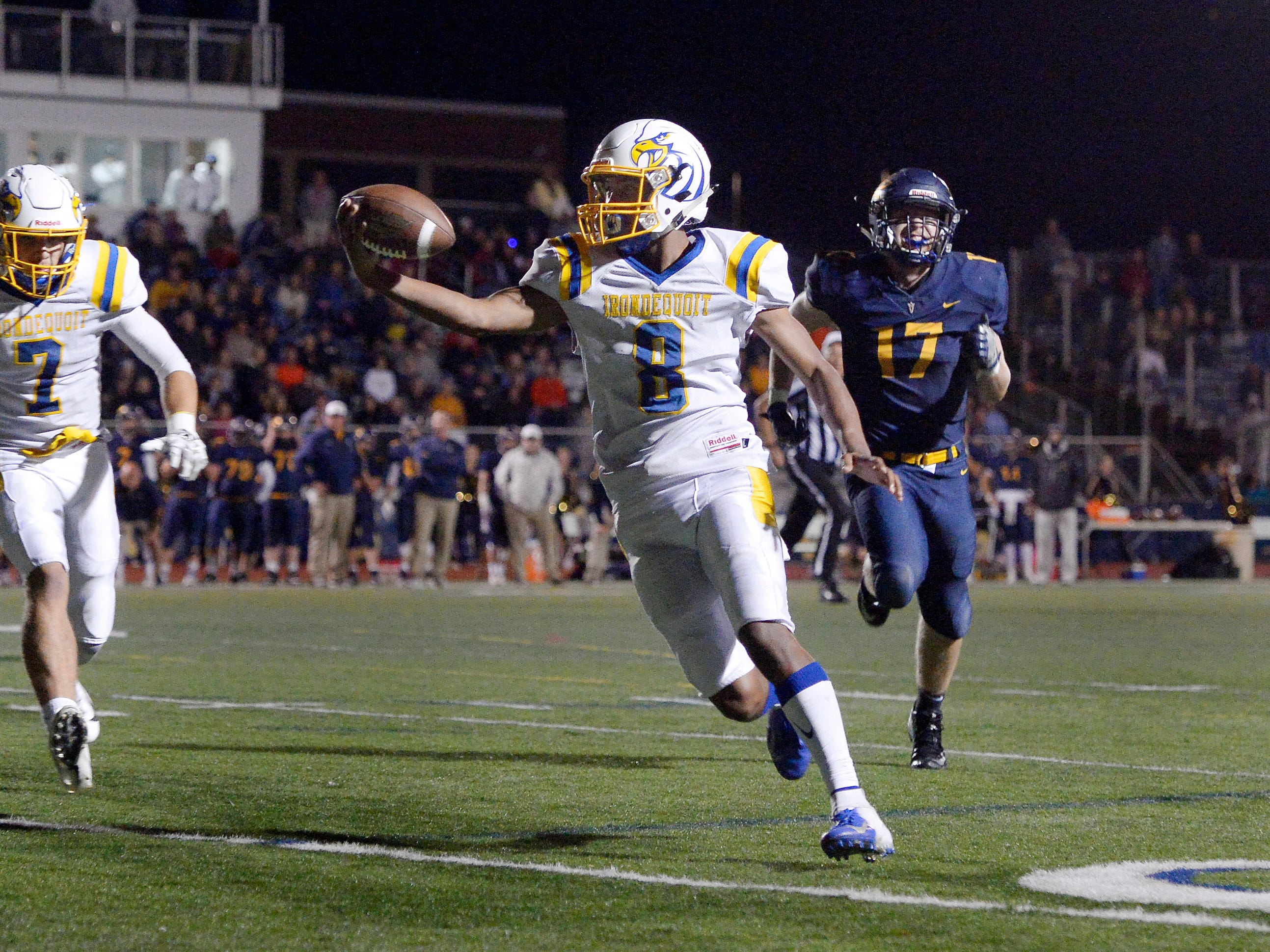 Irondequoit's Freddy June Jr. extends the ball across the goal line for the game-winning touchdown against Victor during a regular season game played at Victor High School, Sunday, Sept. 23, 2018. Irondequoit beat Victor 28-21.