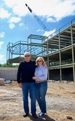 Peter and Susan Schottland visit the construction site of the new Schottland Family Branch YMCA in Pittsford. The Schottlands donated $3.5 million toward the new YMCA location.