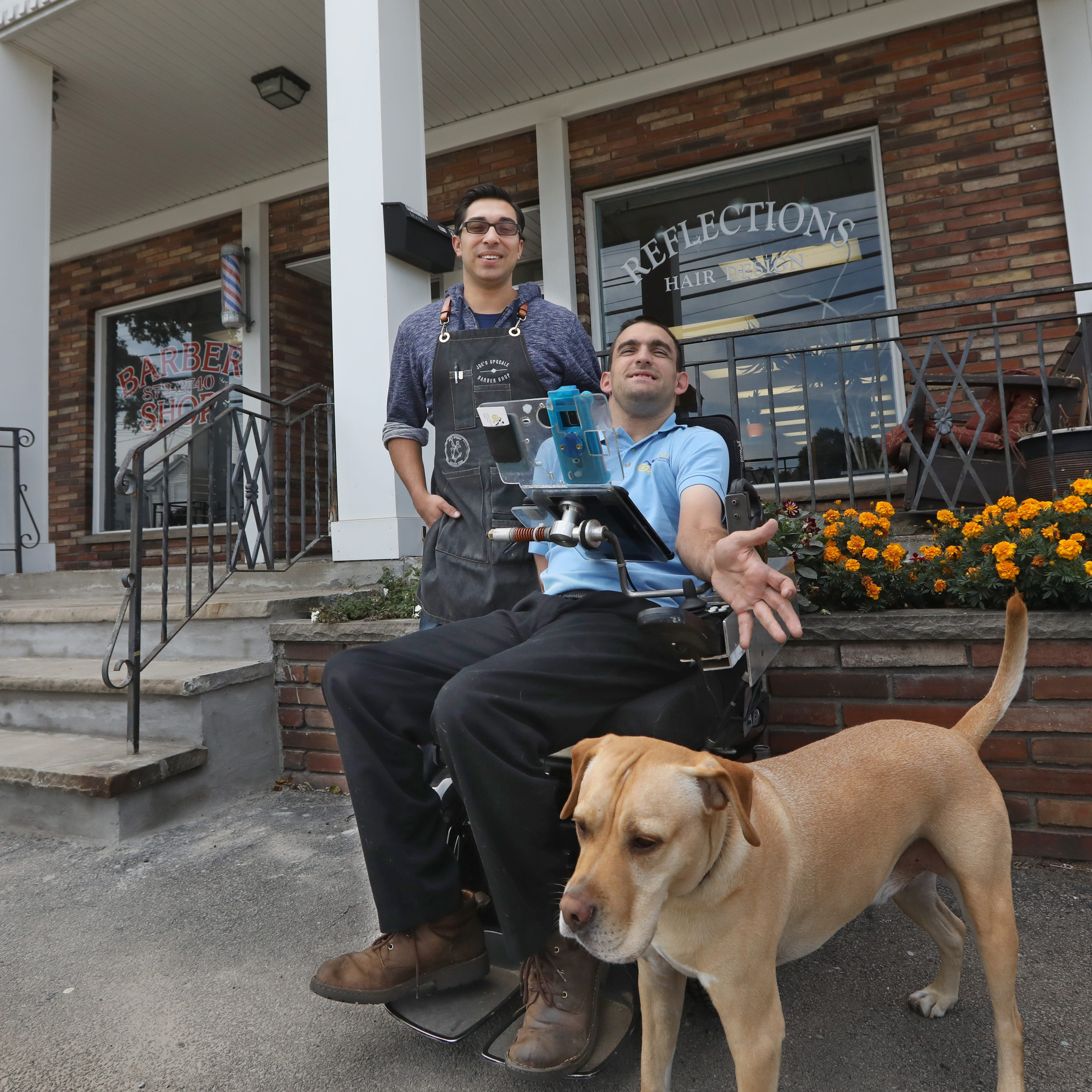 Webster barber receives attention for cutting hair of customer in wheelchair on sidewalk