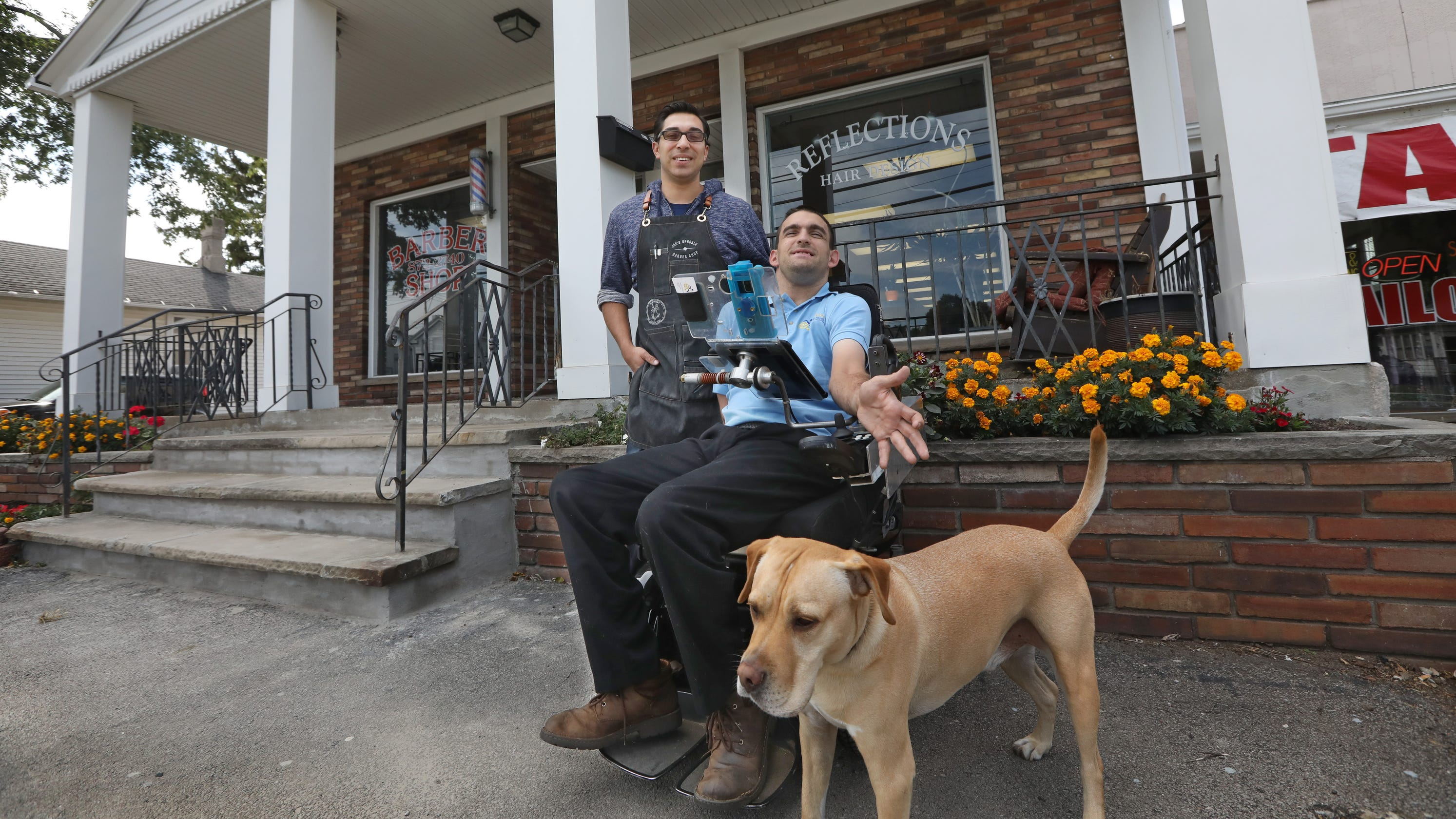 Webster Barber Cuts Hair Of Customer In Wheelchair On Sidewalk