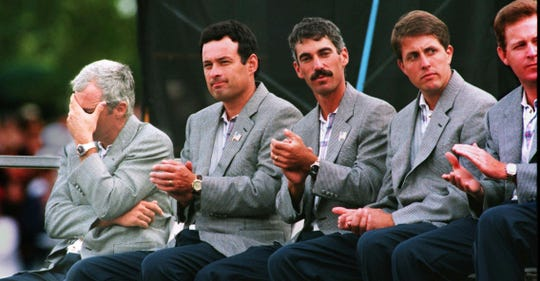 During Ryder Cup closing ceremonies in 1995, Curtis Strange sits with his head in his hand. Strange lost to Nick Faldo in his match Sunday, Sept. 24, as the European team took the Ryder Cup.
