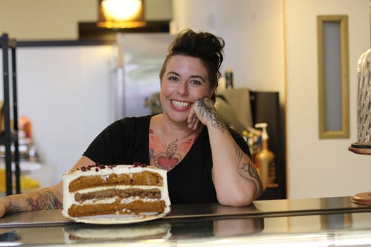Alena Stewart, co-owner of Sweetsmith Salem, here pictured with her Autumn Cake on September 21, 2018.