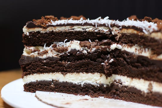 Sweetsmith co-owner Alena Stewart's Nanaimo Cake was inspired by the popular Canadian bar cookie. It's a chocolate cake layered with chocolate ganache, vanilla custard frosting, and chocolate coconut crumble.