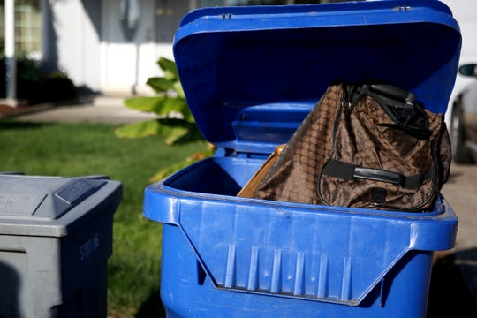 A Salem resident could face fines for attempting to recycle a suitcase on Monday, Sept. 24, 2018 in northeast Salem.