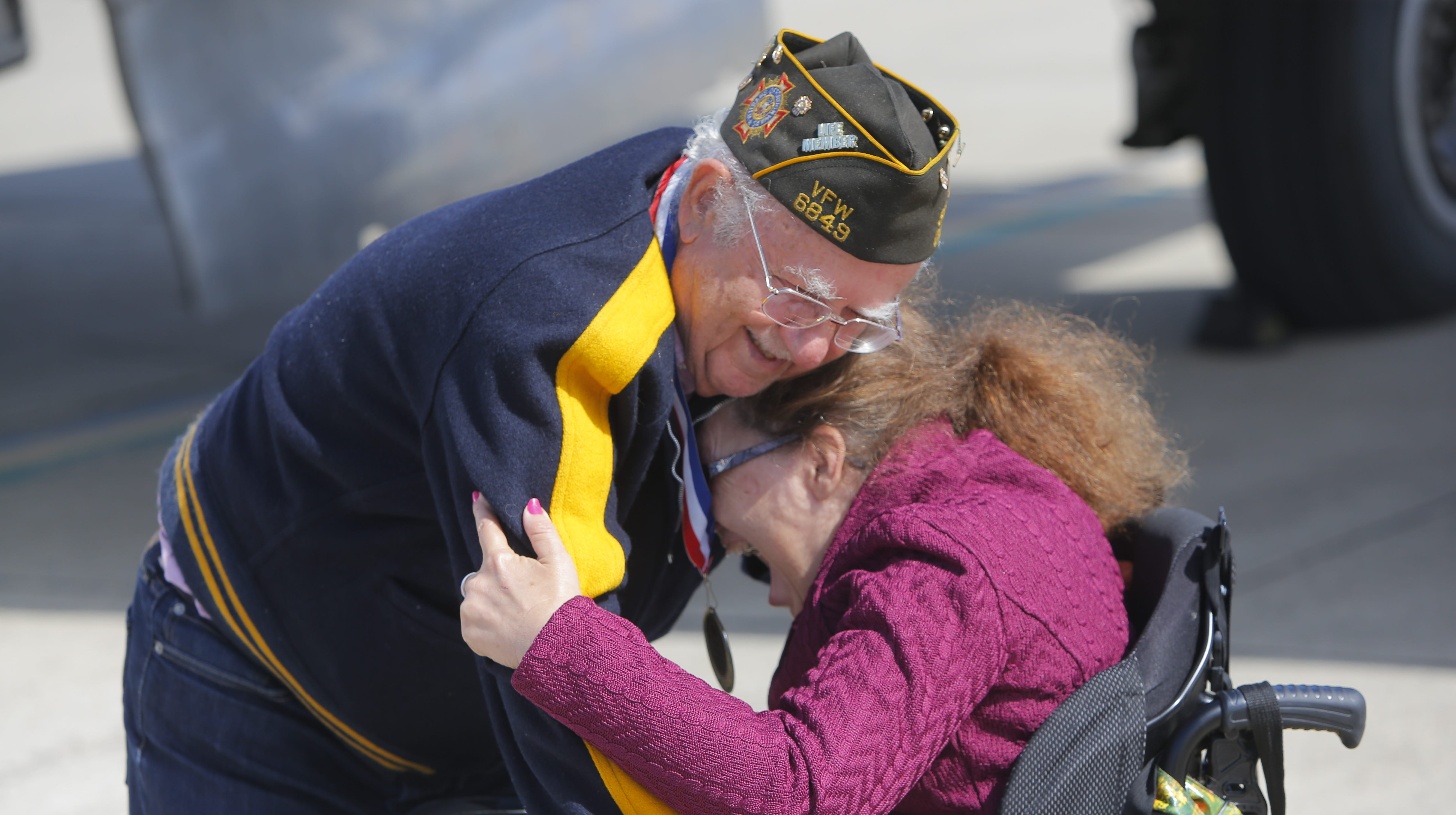 Ray Morasca, of Salinas, hugs his daughter Jeanine Morasca, after he flew in a B-17 Flying Fortress. The plane had come to Salinas for the California International Airshow this weekend. It arrived on Monday and took several passengers, including WWII veteran Ray Morasca, for a spin.