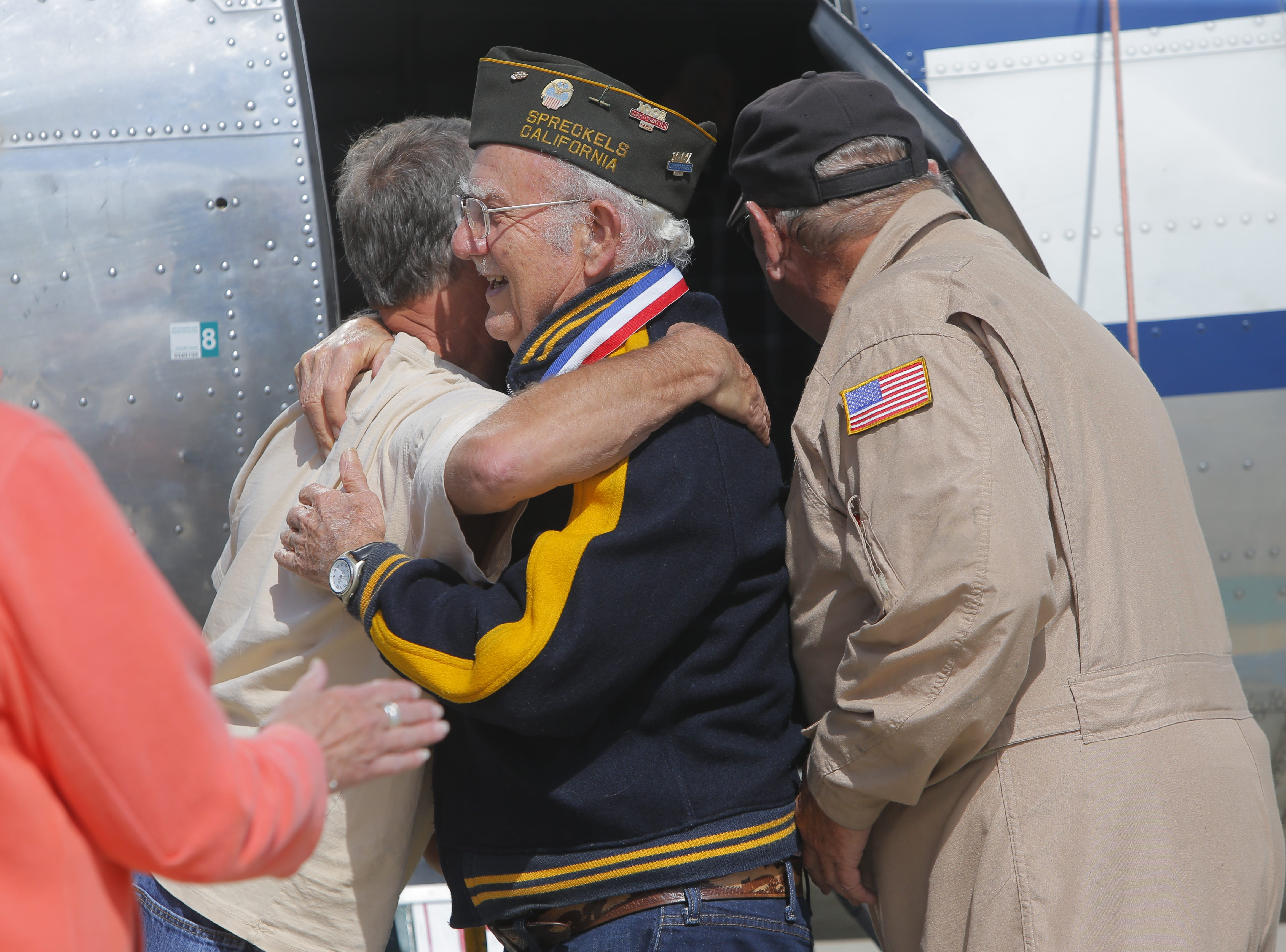 Ray Morasca, of Salinas,embraces a fellow passenger on a flight of a B-17 Flying Fortress Monday. The plane came to Salinas for the California International Airshow this weekend. It arrived on Monday and took several passengers, including WWII veteran Ray Morasca, for a spin.