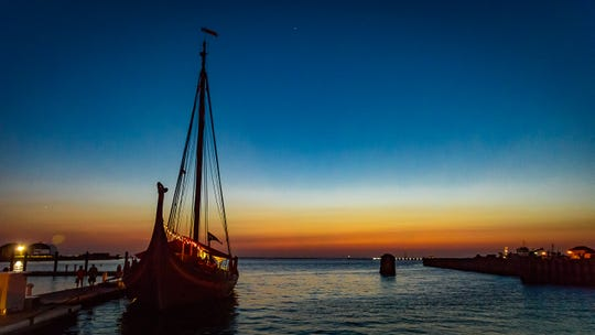The Viking ship Draken Harald Harfagre moored in Cape Charles Harbor Friday evening. She is  in Cape Charles through Sept. 27.
