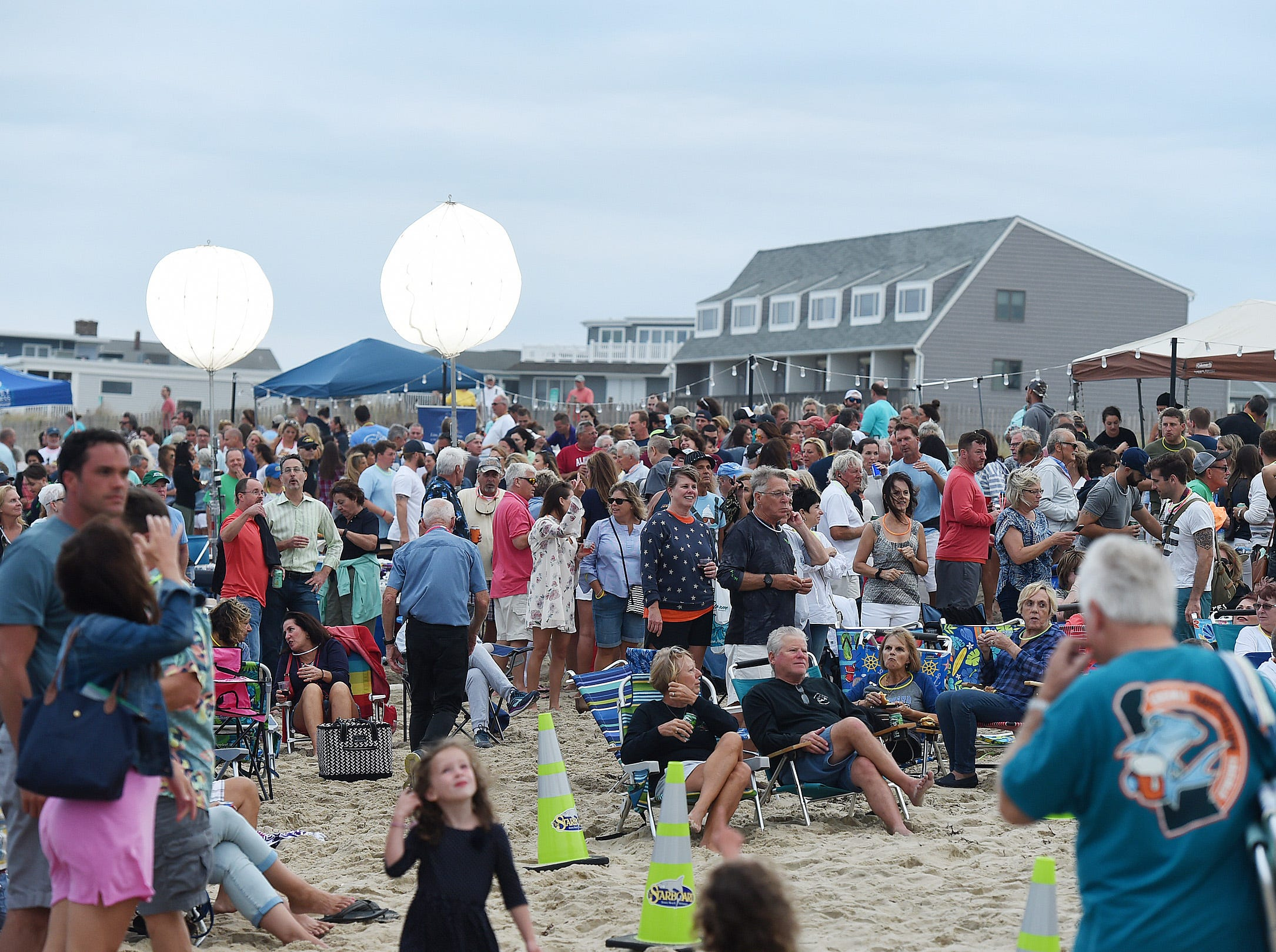 The Dewey Business Partnership held their Annual End of the Summer Season Beach Party on the beach at New Orlean's Street on Saturday evening Sept. 24 with over 800 people coming to say goodbye to summer and party and listen the Joe Bachman and his Band perform. Food from several Dewey Beach Restaurants was available along with games for the kids and a large bonfire. A full moon finished the night as the tide rolled in.