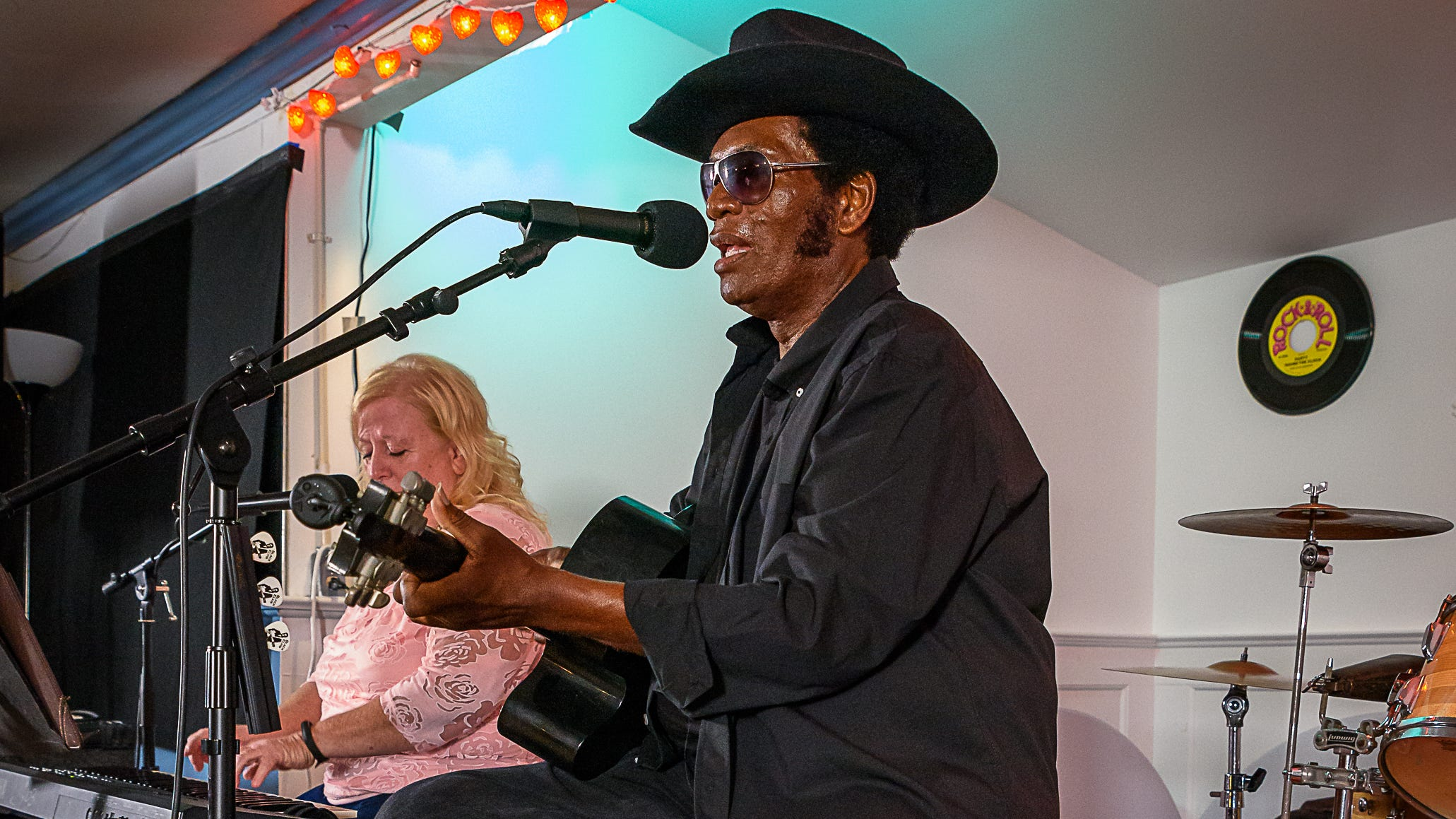 Legendary Eastern Shore performer, Black Elvis, along with his keyboardist, Snowflake. sings for the crowd at Giddens' Do Drop Inn's 50th anniversary celebration in Weirwood on Sept. 22.