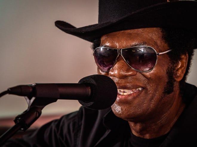 Legendary Eastern Shore performer, Black Elvis, sings for the crowd at Giddens' Do Drop Inn 50th anniversary celebration.