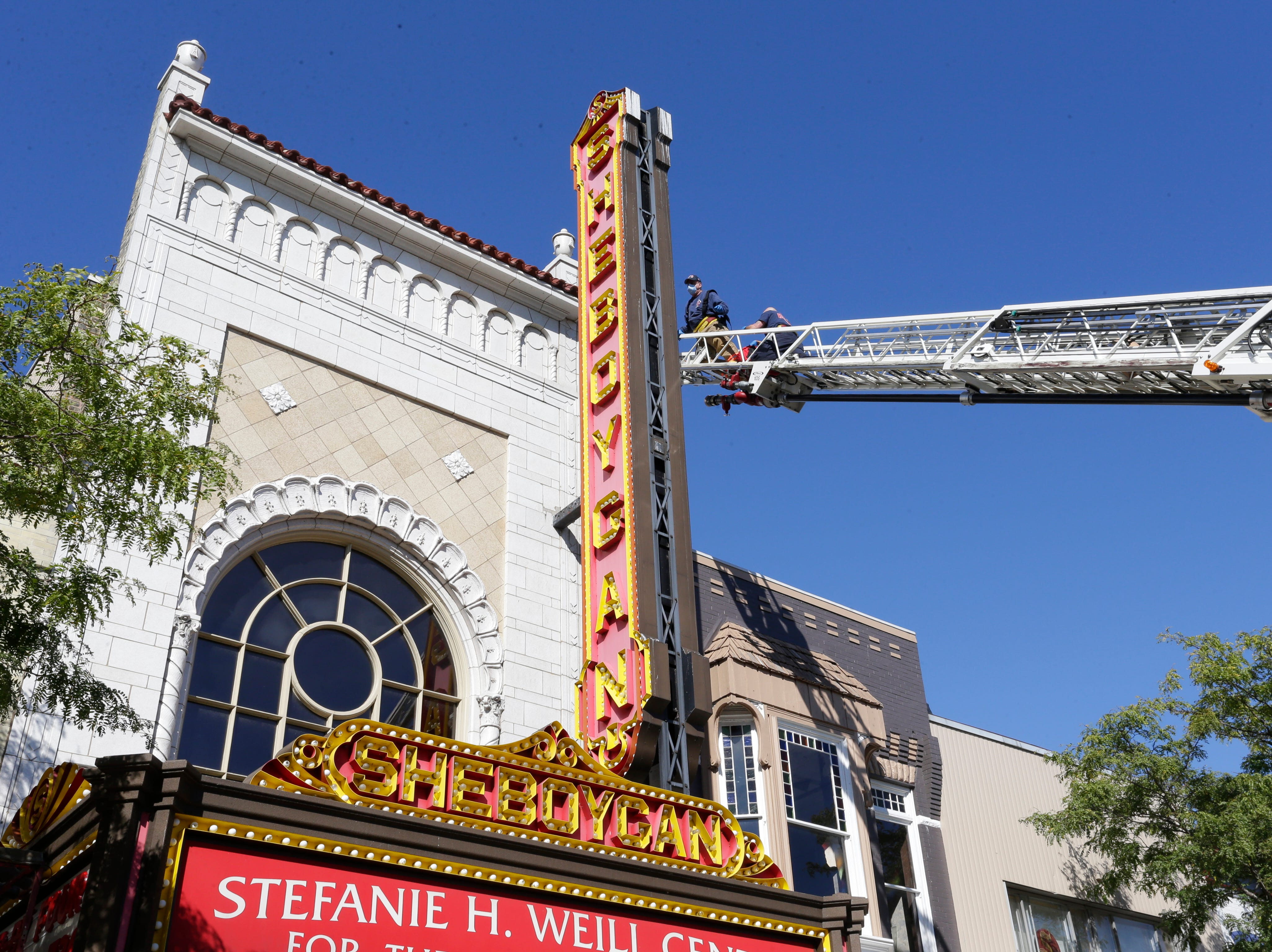 The boom of the City of Sheboygan Fire Department truck reaches out to the marquee of the Stefanie H. Weill Center for the Performing Arts, Sunday, September 23, 2018, in Sheboygan, Wis.