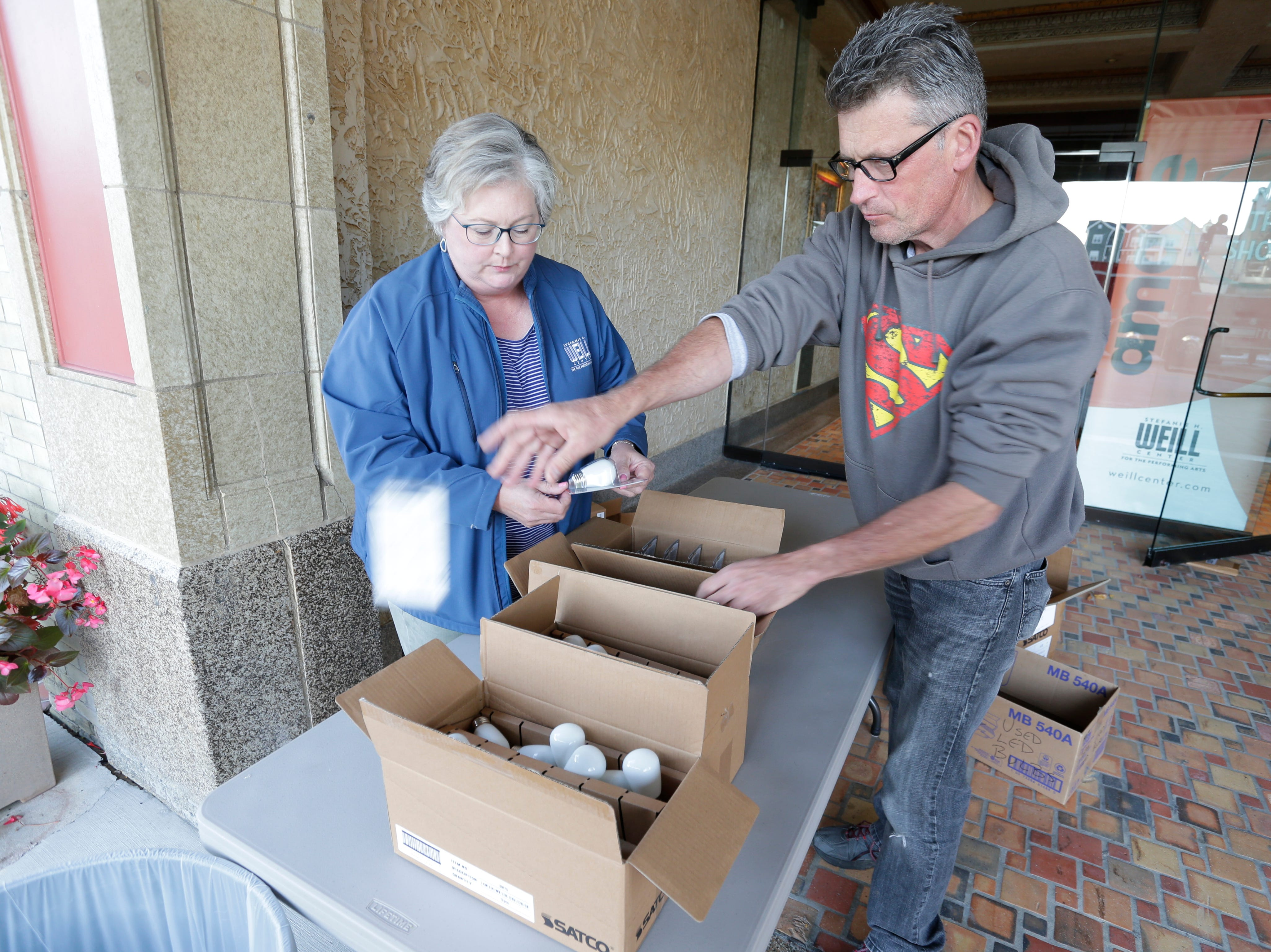Stefanie H. Weill Center for the Performing Arts manager Kimberly Meller, left, and her husband Henry, unpack new LED lightbulbs for the marquee of the Center, Sunday, September 23, 2018, in Sheboygan, Wis. Meller said that the conversion project should wrap up in the next few weeks.