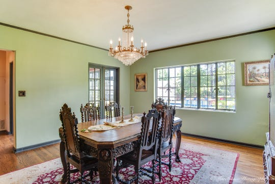 The dining room's sparkling crystal chandelier will add elegance to any dinner party.