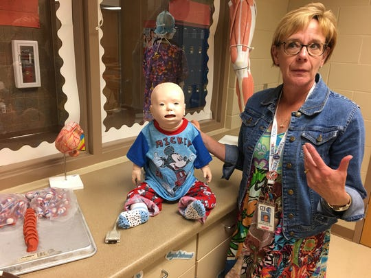 Health Careers 1 teacher Colleen Johnson talks about how a $10,000 donation helped pay for three new mannequins, including a baby mannequin, students can use for the first time this year.