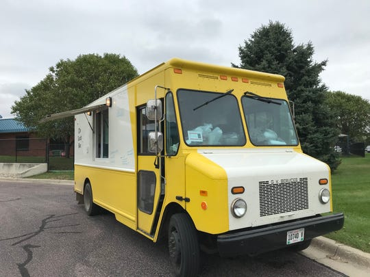 The Lunch Box food truck parks in a northern Sioux Falls parking lot for its Monday lunch rush.