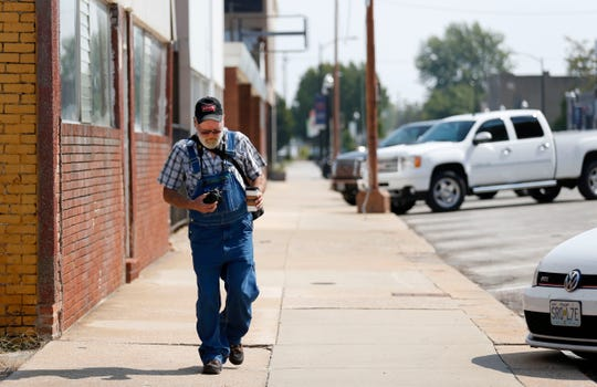Art Elwell walks down Commercial Street with his camera on Thursday, Sept. 20, 2018. Elwell, who is no longer homeless after settling in upstate New York, is visiting Springfield for a month after traveling the country the past year.