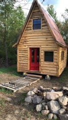 This is Art Elwell's new home, a tiny cabin in upstate New York. The red door was installed last week. Elwell had been homeless for about eight years.