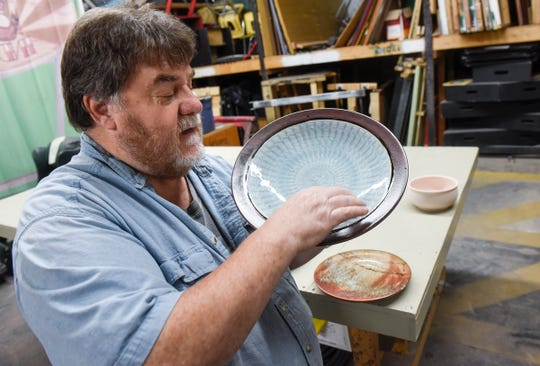 David Glenn talks about the process used in his artwork Wednesday, Sept. 19, at the Paramount Center for the Arts technical building in Waite Park.