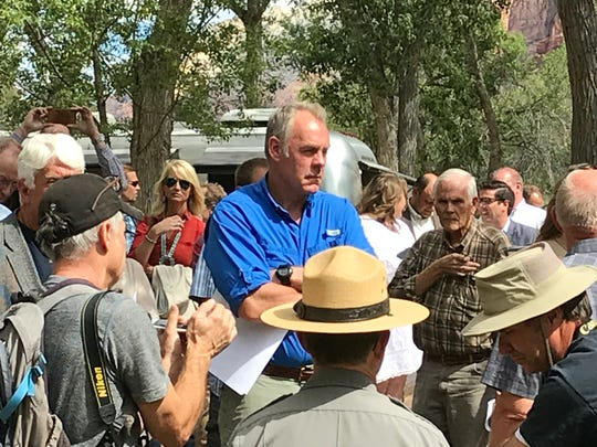 Interior Secretary Ryan Zinke hears from park officials during a visit to Zion National Park Sept. 24, 2018.