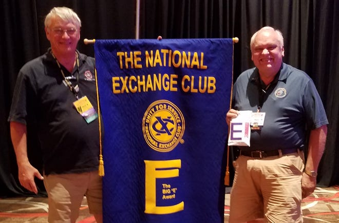 Neal Smith, left, and Floyd Holm, members of the St. George Exchange Club, pose next to The BIG E Award, a recognition given to the club at the recent Exchange Club National Convention in Reno, Nevada.