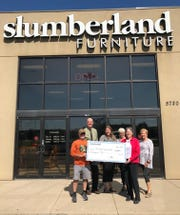 Mary Hesch (second from right), local owner of Slumberland Furniture in Stevens Point donates $10,000 to the Green Circle Trail.