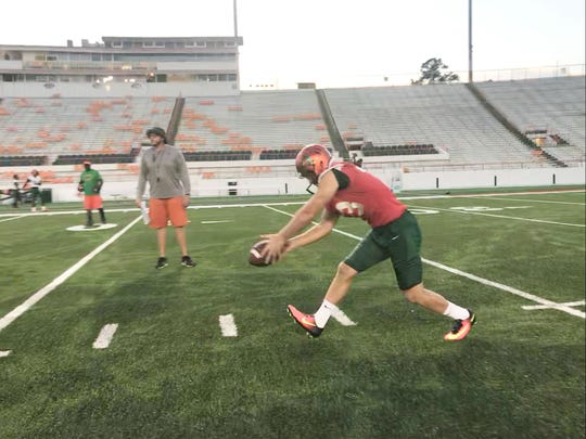 FAMU punter Chris Faddoul gets set to blast a kick in practice.