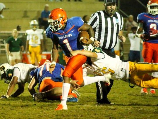 Taylor County quarterback Da'corian Bellamy heads towards the end zone in a preseason game against Ocala Forest.