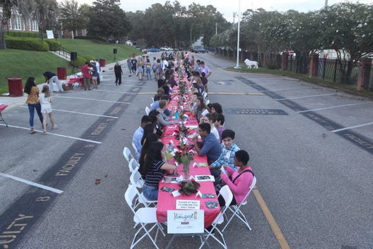 Two hundred fifty students gathered for The Longest Table event in the parking lot of Leon High School in Tallahassee, Fla. Sunday, Sept. 23, 2018 for the event.
