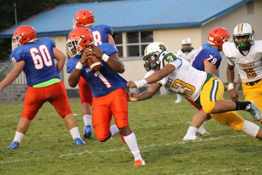 Taylor County quarterback Da'corian Bellamy tries to avoid an Ocala Forest pass rusher.