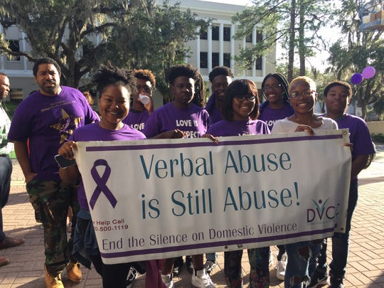 Participants gather for a photo at last year's March to End the Silence on Domestic Violence.