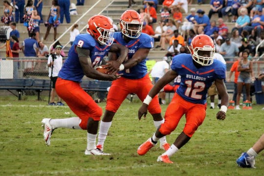 Taylor County quarterback Da'corian Bellamy runs a read option play with running back Buddy McGrew.
