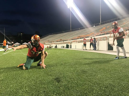 Chris Faddoul performs double duty on special teams. In addition to punting, he's the holder for field goals and extra points. Yahia Aly lines up to kick angled field goals in practice.