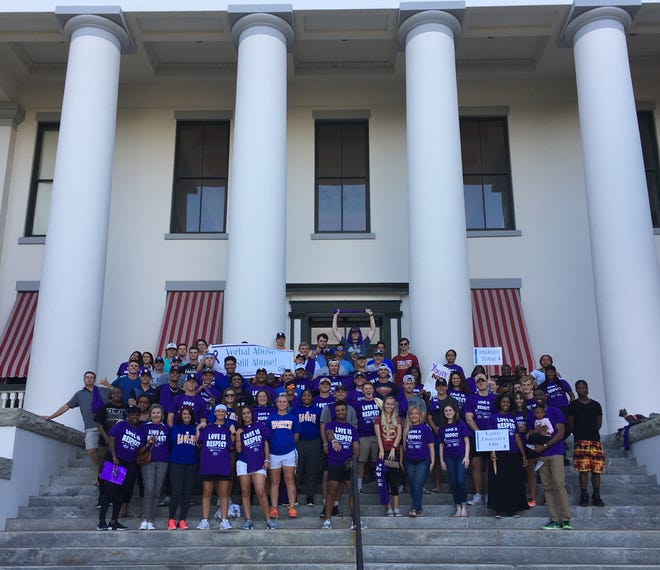 Participants gather for a photo on the Capitol steps at last year's March to End the Silence on Domestic Violence.