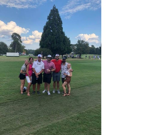 Former FSU baseball player Jimmy Marshall, center, with family friends Sunday at the Tour Championship in Atlanta.