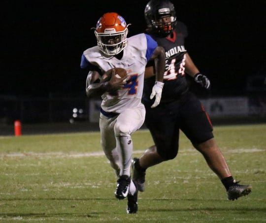 Taylor County's Robert Glanton heads upfield on a touchdown run against Fort White.