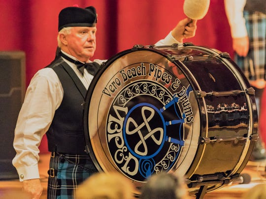 Drum Sgt. John Thompson plays bass drum at a performance of the Vero Beach Pipes and Drums.