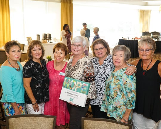 Lorraine Cardarelli, left, Doris Medwin, Deborah Lovequist, honoree Joanne Dougherty, Donna Vestal, Lesley Ludlum, and Joy Burr at the Hope Awards Recognition Breakfast at Monarch Country Club onSept. 13.