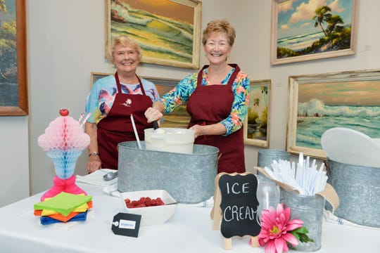 "Pat Donaldson and Sue Ritter scoop ice cream at the A.E. Backus Museum & Gallery in Fort Pierce during the pre-season exhibition of ""First Response: Photographs by Rusty Wiles."""