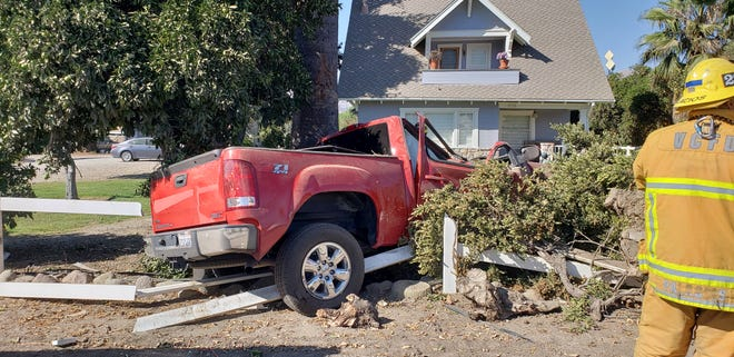 Firefighters extricated a driver trapped in a truck that crashed into a tree outside Fillmore Sunday.