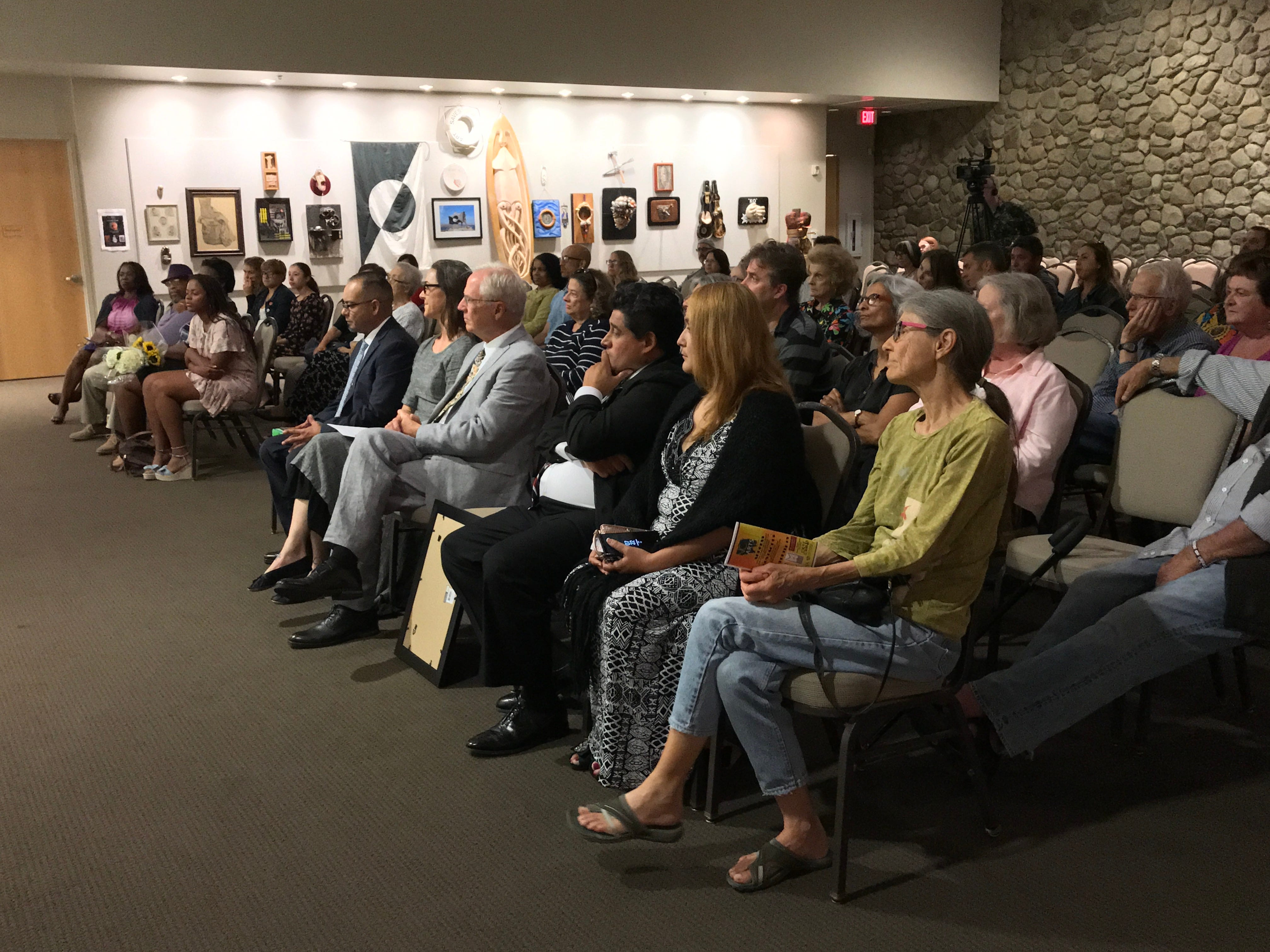 The audience listens to young people reading poetry during the inauguration of the first youth poet laureate at the Museum of Ventura County.